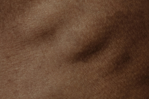 Ribs. detailed texture of human skin. close up shot of young african-american male body. skincare, bodycare, healthcare, hygiene and medicine concept. looks beauty and well-kept. dermatology.