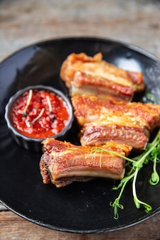 Ribs fried grill pork or beef bbq fat food spices spicy fresh meal snack on the table copy space