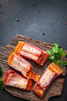Ribs raw meat pork spices paprika herbs fresh meal snack on the table copy space food background