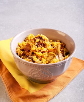 Ribs with rice casserole in a bowl