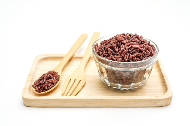 Rice berry in a spoon and bowl on a white background.