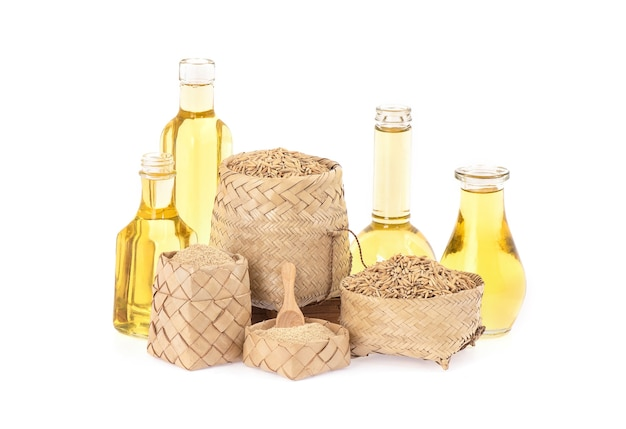 Rice bran and oil isolated on white.