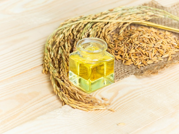 Rice bran oil on wooden background. food and healthcare concept.