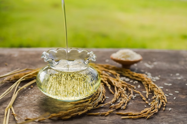 Rice bran oil on wooden table. food and healthcare concept.