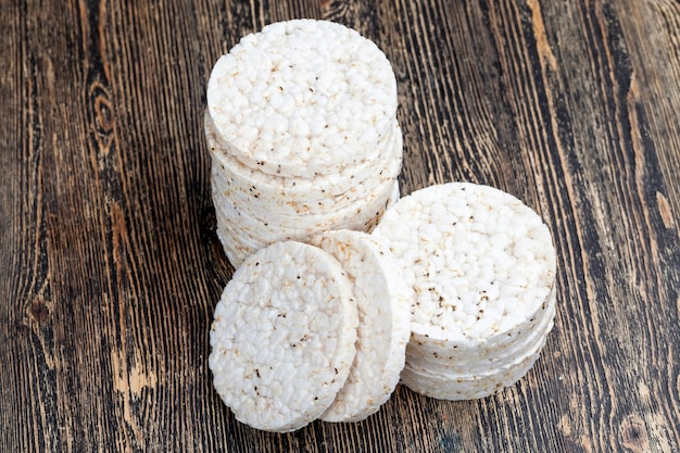 Rice breads made from rice cereals, blasted and processed rice from which crusty breads are made