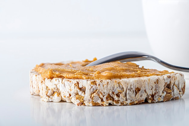 Rice cakes with homemade creamy peanut butter or paste