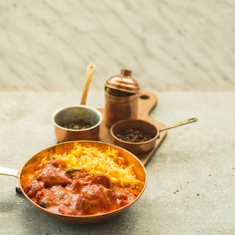 Rice dish with sauce near spices
