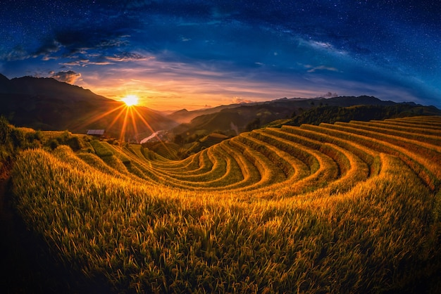 Rice fields on terraced with milky way at sunset in mu cang chai, yenbai, vietnam