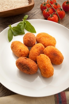 Rice fried croquettes dish