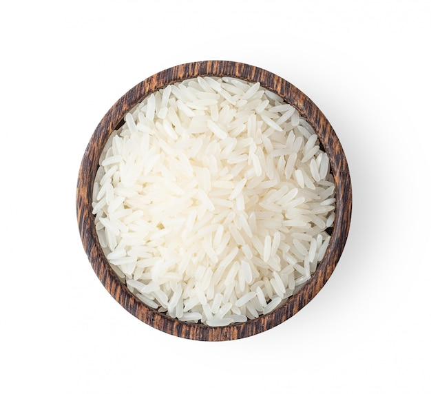 Rice grains in wood bowl isolated