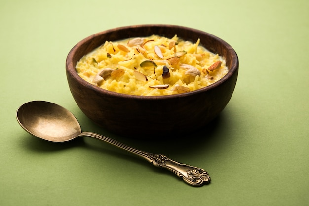 Rice kheer or pudding from india also called as firnee. served in a bowl. selective focus