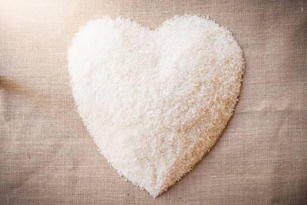 Rice laid out in heart shape on sackcloth