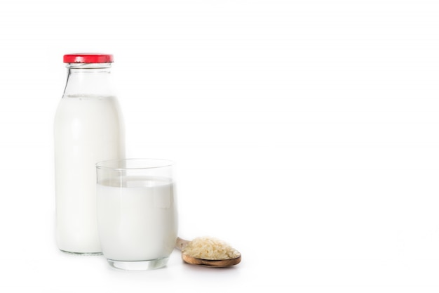 Rice milk in glass isolated on white, copy space