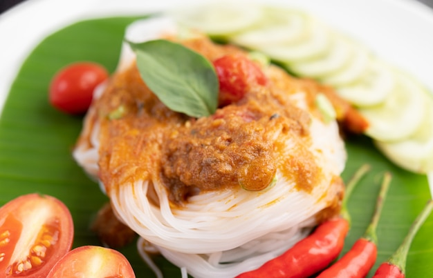 Rice noodle noodles topped with coconut milk.
