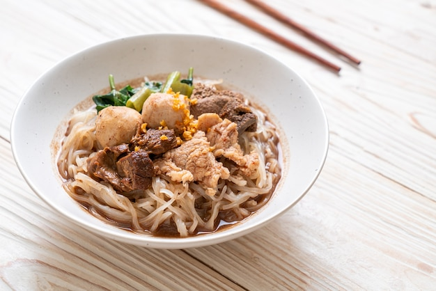 Rice noodle soup with stewed pork - asian food style