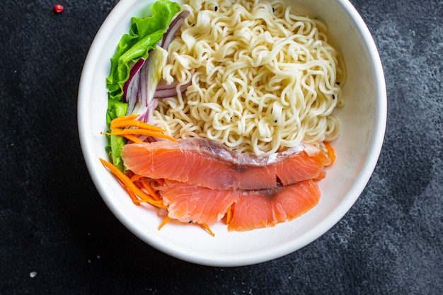 Rice noodles salmon seafood or wheat glass cellophane pasta ready to eat