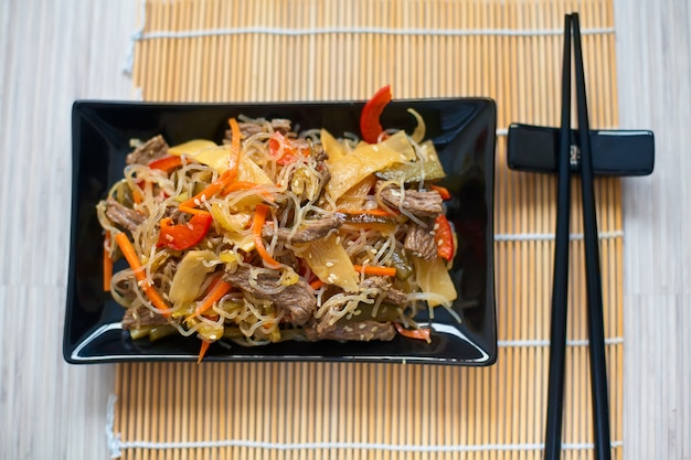 Rice noodles with meat and vegetables