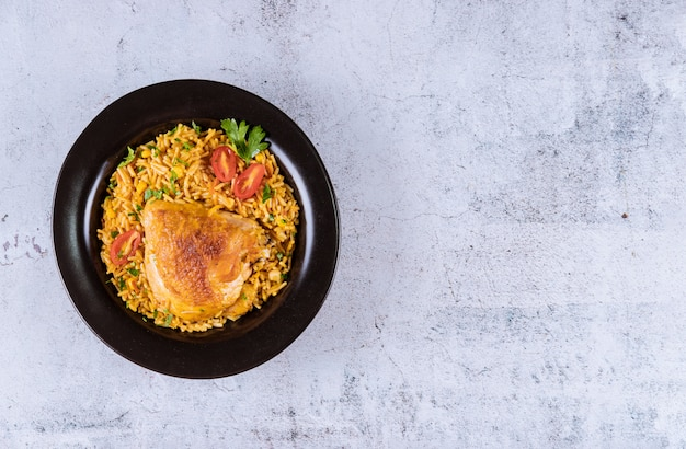 Rice and pasta with vegetables and chicken. asian food.