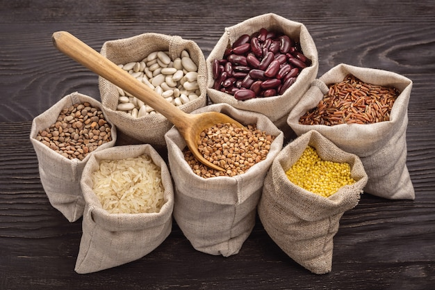 Rice, peas, beans and cereals in bags. closeup