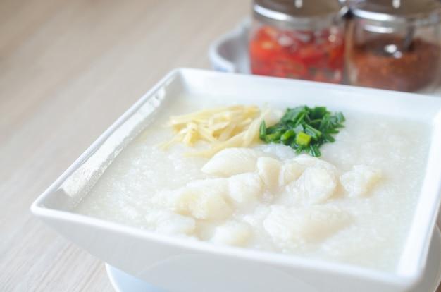Rice porridge with fish. fish congee. asia food