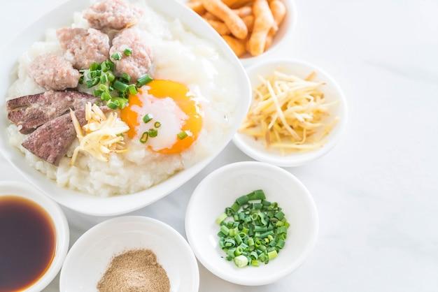 Rice porridge with pork and egg