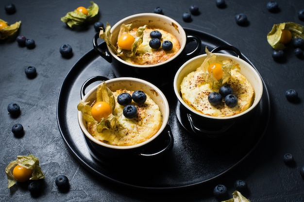 Rice pudding. blueberries and physalis.