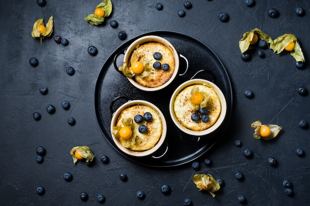 Rice pudding dessert. blueberries and physalis.