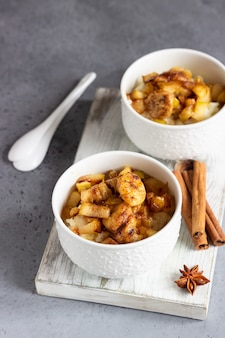 Rice pudding with fruits, honey and spices. healthy breakfast or dessert.