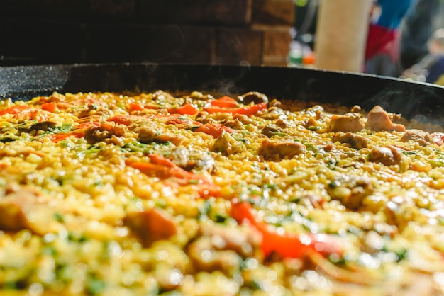 Rice and rabbit, typical dish of the gastronomy of the region of murcia, spain, cooked in a paella pan.