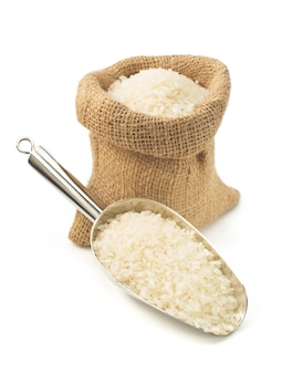 Rice in scoop isolated on white