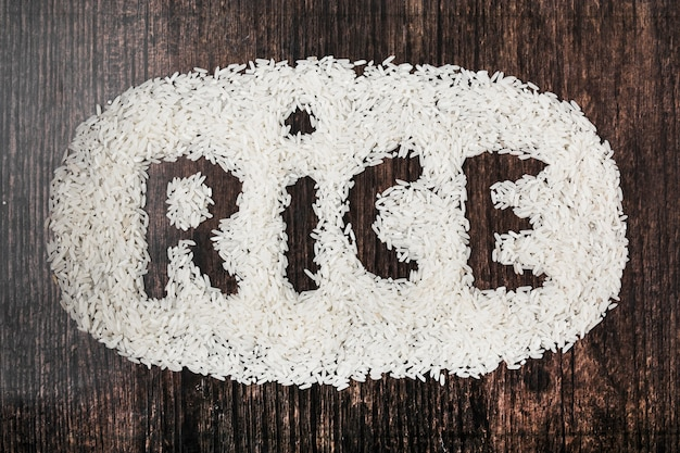 Rice text on black wooden textured background