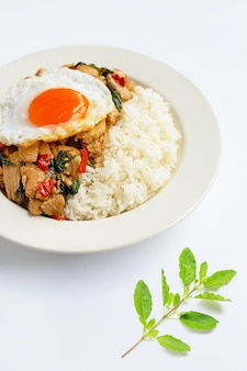 Rice topped with stir-fried chicken and holy basil