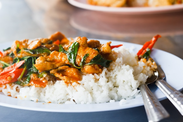 Rice topped with stir-fried meat and basil