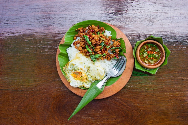 Rice topped with stir-fried minced pork and basil with fried egg.