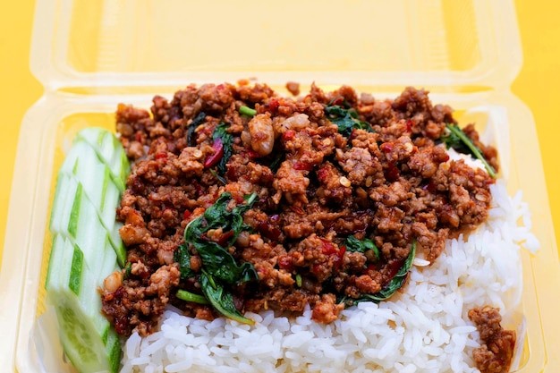 Rice topped with stir-fried pork with holy basil