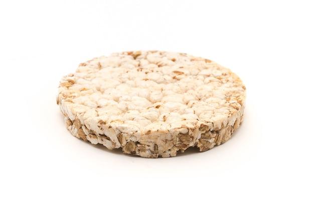 白い背景の上に分離された米小麦パン