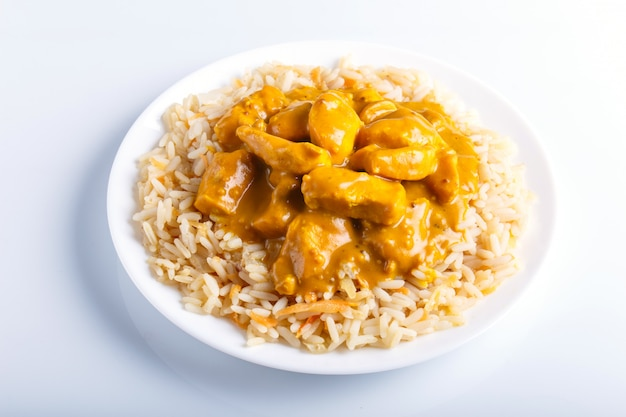 Rice with chicken curry sauce with cashew