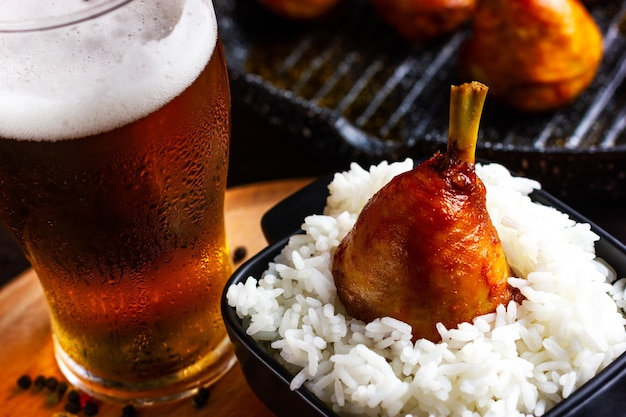 Rice with fried chicken and a glass of beer grill menu in a pub