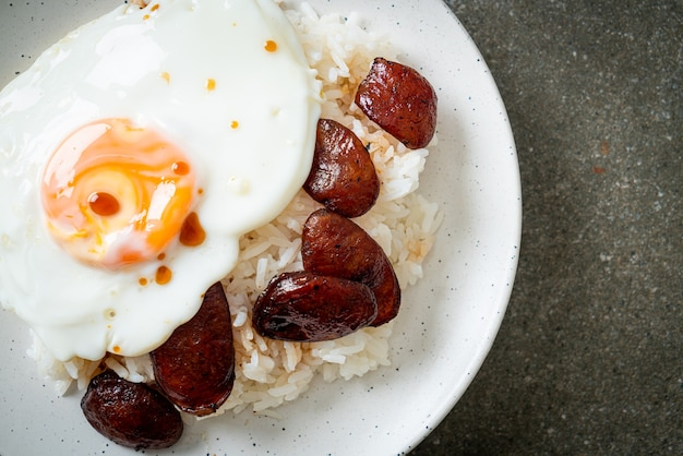 Rice with fried egg and chinese sausage - homemade food in asian style