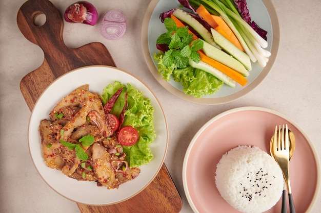 Rice with grilled pork neck. grilled pork salad thai food with herbs and spices ingredients, tradition northeast food delicious with fresh vegetables, hot and spicy slice grilled pork menu asian food.