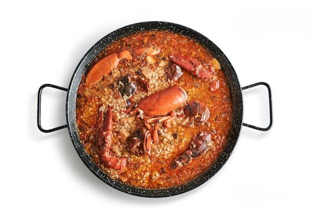Рис с лобстером на сковороде