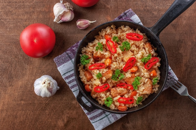 Rice with meat, vegetables and parsley in a serving pan