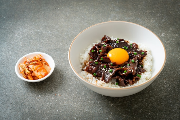 Rice with soy-flavoured pork or japanese pork donburi bowl - asian food style