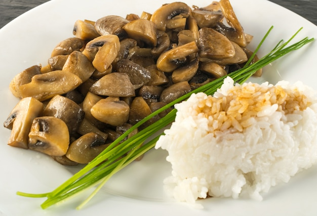 Rice with soy sauce and mushrooms. fried champignons macro