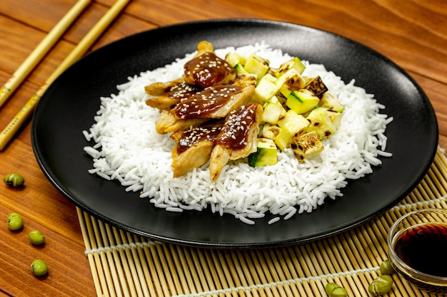 Rice with vegetable protein, teriyaki sauce, and grilled zucchini