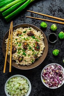 Rice with vegetables and meat on wooden table
