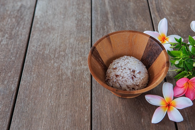 Rice in a wooden cup on a wooden floor table