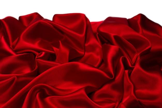 リッチで豪華な赤いシルク生地のテクスチャ背景。上面図。
