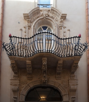 Rich baroque balcony of old palace in ortigia