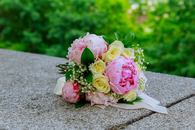 Rich bouquet of pink peonies and white roses eustoma flowers, green leaves fresh spring bouquet.